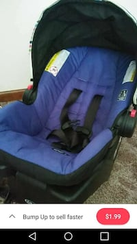 black and blue car seat carrier