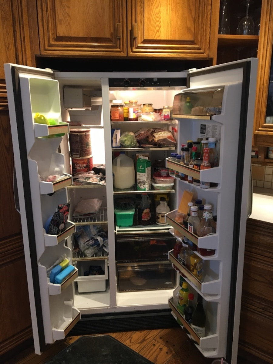 Side by side fridge... price reduced for quick sale.  Works perfectly. - Calgary