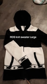 large white and black knit hooded sweater