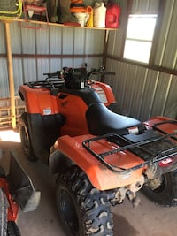 orange and black ATV Plaucheville, 71362