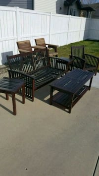 rectangular black wooden table with four chairs patio set Lethbridge, T1J 1M7