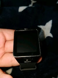 black and silver smart watch St. Catharines, L2S 2P2