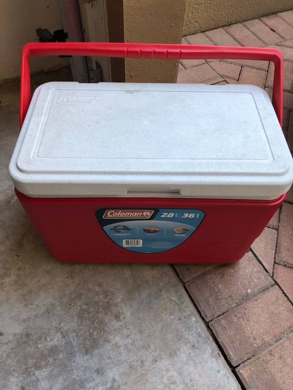 Red and white coleman cooler