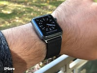 black Apple iWatch with black milanese strap