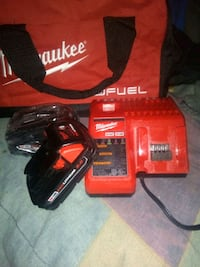 Milwaukee charger with 2 never been used m18 batt 1119 mi