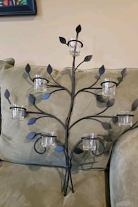 7 candle wrought iron wall decor