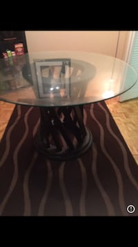 round glass top table with black metal base Montréal, H3E 1G2