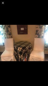 Round glass/wood table, table cloth and two chairs with covers  Fayetteville, 72703