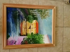 river painting with brown wooden frame