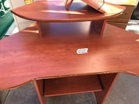 Desk - Wooden Space-Saving corner unit.  On casters rolls/ moves very easy! Albuquerque, 87107