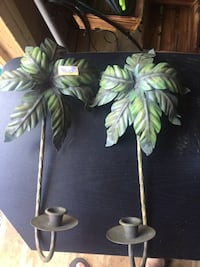 Green metal palm tree wall candle holder