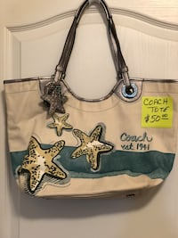 white and black Juicy Couture tote bag New Smyrna Beach, 32168