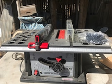 gray, black, and red table saw