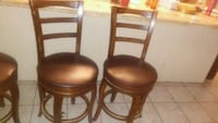 three brown wooden padded leather bar stools Phoenix, 85017