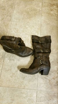 pair of black leather 3-buckle chunky heel high-top boots Orem, 84097