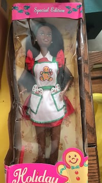 black haired female in red and white dress plastic doll