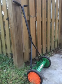 green and black string trimmer 544 mi