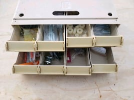Drawer cabinet with miscellaneous screws and bolts