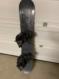 Snowboard with boots and glasses