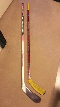 two assorted-color-and-brand hockey sticks 3149 km