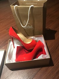 pair of red Christian Louboutin stiletto shoe with box New York, 11233