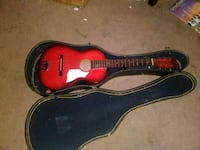 red and black acoustic guitar in case Tecumseh, 74873