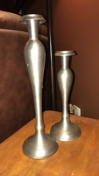 two gray stainless steel candle holders , 02717