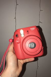 Fujifilm Instax Mini 8 polaroid camera with case