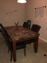 rectangular brown marble-top table with black wooden base El Paso