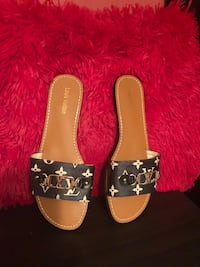 pair of black-and-brown sandals Winter Park, 32792
