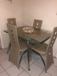 Rectangular glass top table with four chairs dining set (arrange pickup) Perth Amboy, 08861