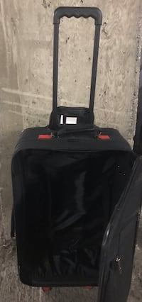 Carryon for $10 used condition but still inside clean and zipper and wheels and Handel is fine  North Vancouver, V7K 1A7