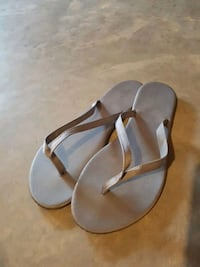pair of gray leather sandals