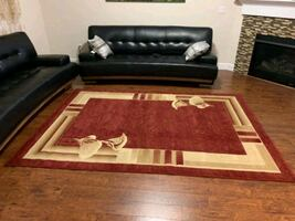 3 area rugs, one is larger than the other
