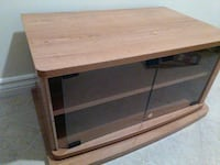 Swiveling tv stand with glass doors