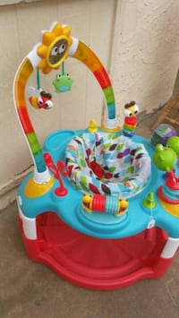 baby's blue and red activity saucer El Paso, 79904