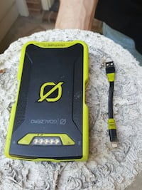 black and green Goalzero power bank with USB cable