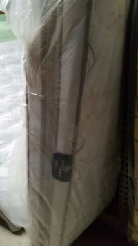 white and gray quilted mattress 143 mi