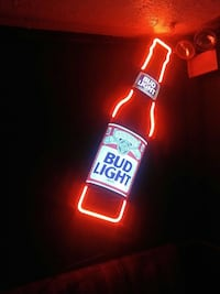 red, blue, and white Bud Light signage