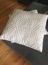 White and gray chevron print textile.