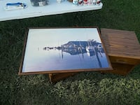 brown wooden framed sea docks painting