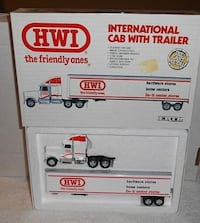 "brand new in the box 1989 Ertl ""HWI"" International Cab With Trailer. 1:64 Scale. Made of Die-Cast Metal.    TROY"