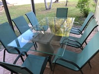rectangular glass-top table with four chairs 779 mi