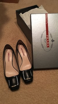 pair of black Prada leather square-toe pump shoes with box
