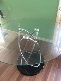 Round glass top table with stainless steel base