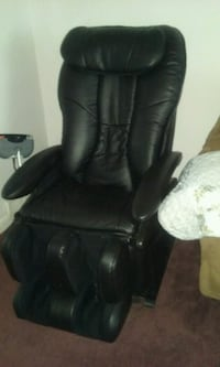 black leather padded rolling armchair null