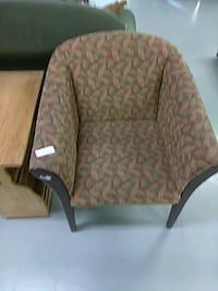 black wooden framed beige, maroon and green cushioned armchair 421 mi