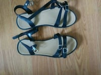 pair of black leather open-toe sandals Edmonton, T5X 4G9