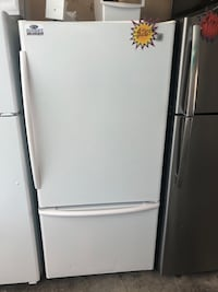 A white french door refrigerator  Lehigh Acres, 33973