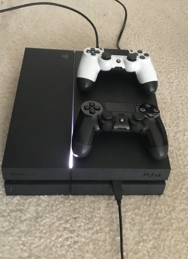PS4 w/ two controllers d2559f38-2626-4329-a6df-c9cd3b9ea689